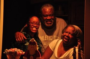 My twin sister Shannon, dad, and mom.